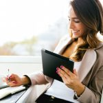 Business woman using mobile device to apply for financing